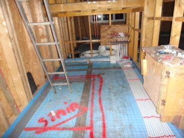 the underfloor heating pipes all run to under the stairs